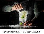 bartender squeezing juice from... | Shutterstock . vector #1040403655