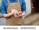 waiter taking order from... | Shutterstock . vector #1040410231