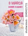 "Small photo of bunch of beautiful pink-yellow tulips in vintage style metal pot for Women`s Day in Poland with greetings ""All the best "" written in polish on paper label"