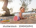 kid playing with beach toys in... | Shutterstock . vector #1040426941