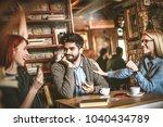 tree young friends spending... | Shutterstock . vector #1040434789