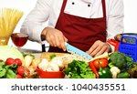 male hands cut mushroom with... | Shutterstock . vector #1040435551