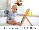 cute little baby boy  playing...   Shutterstock . vector #1040441335