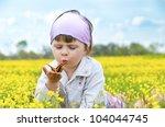Little Cute Girl In A Field Of...