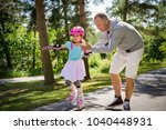 father teaching his daughter to ... | Shutterstock . vector #1040448931