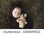 little baby boy with knitted... | Shutterstock . vector #1040449321