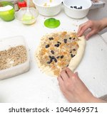 woman making pie from pastry at ... | Shutterstock . vector #1040469571