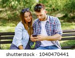 young couple having fun with a... | Shutterstock . vector #1040470441