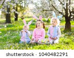 kids with bunny ears on easter... | Shutterstock . vector #1040482291