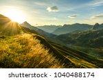 beautiful sunrise and layered... | Shutterstock . vector #1040488174
