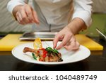 chef is decorating a dish  ...   Shutterstock . vector #1040489749