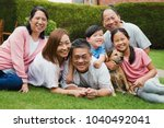 happy family portrait. chinese... | Shutterstock . vector #1040492041