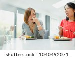 two women are sitting with... | Shutterstock . vector #1040492071