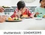 close up shot of a little boy... | Shutterstock . vector #1040492095