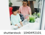 little girl is doing the chores ... | Shutterstock . vector #1040492101