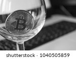 bitcoin in a glass on laptop... | Shutterstock . vector #1040505859