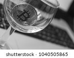 bitcoin in a glass on laptop... | Shutterstock . vector #1040505865