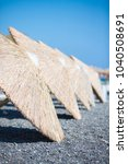 beach sunshades on the southern ... | Shutterstock . vector #1040508691