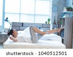 asian women exercising in bed... | Shutterstock . vector #1040512501