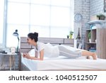 asian women exercising in bed... | Shutterstock . vector #1040512507