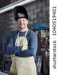 worker or welder with self... | Shutterstock . vector #1040519401