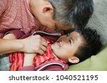 close up shot of a little boy...   Shutterstock . vector #1040521195