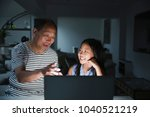 little girl is laughing as her...   Shutterstock . vector #1040521219