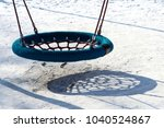 empty children's swing in the... | Shutterstock . vector #1040524867