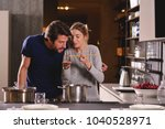 an engaged couple cook together ... | Shutterstock . vector #1040528971