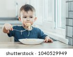 the child in the kitchen at the ... | Shutterstock . vector #1040529949