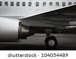 Side view of aircraft fuselage and engine - stock photo