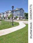 sidewalk leading to suburban... | Shutterstock . vector #104054771