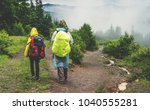 two hikers tourist in raincoat... | Shutterstock . vector #1040555281