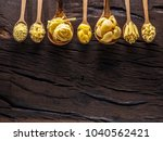 different pasta types in wooden ... | Shutterstock . vector #1040562421