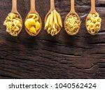 different pasta types in wooden ... | Shutterstock . vector #1040562424