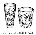 glass with water and ice.... | Shutterstock .eps vector #1040562469