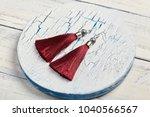 red tassel earrings on white... | Shutterstock . vector #1040566567