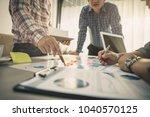 brainstorming group of people... | Shutterstock . vector #1040570125