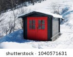 vivid red hut on snow covered... | Shutterstock . vector #1040571631