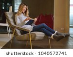 a woman in her living room... | Shutterstock . vector #1040572741
