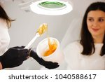 female cosmetologist holding... | Shutterstock . vector #1040588617