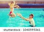 happy active family young... | Shutterstock . vector #1040595361