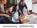 group of young designers... | Shutterstock . vector #1040607181