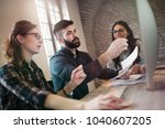 group of young designers... | Shutterstock . vector #1040607205