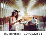 happy woman tourists in the... | Shutterstock . vector #1040622691