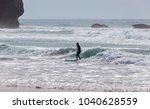 surfer on the beach of arrifana ...   Shutterstock . vector #1040628559