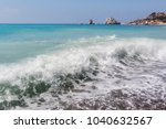 a wave on the beach near the... | Shutterstock . vector #1040632567