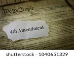 Small photo of 4th Amendment newspaper headline on a copy of the US Constitution