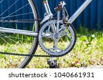 Small photo of Chainring and chain with front derailleur, crank and pedals on vintage racing bicycle with crome frame