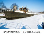 frozen river ships in ice | Shutterstock . vector #1040666131